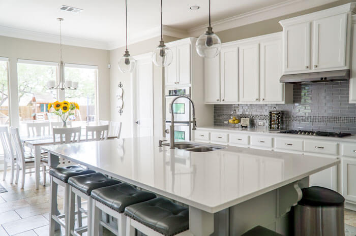 Custom kitchen designs include islands and kitchen cabinets
